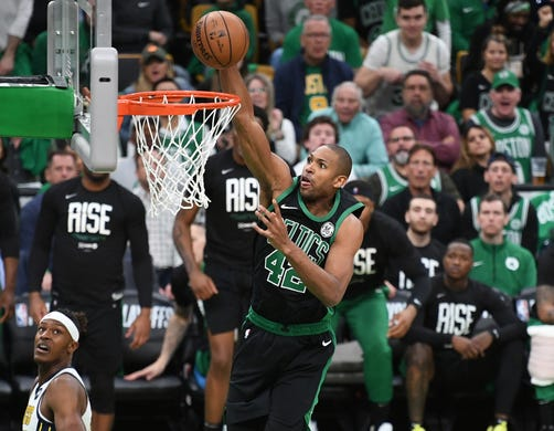 April 14: Celtics center Al Horford throws down the one-handed slam during Game 1 against the Pacers.