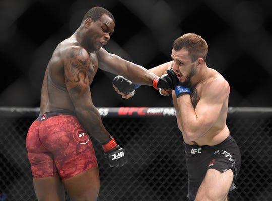 Ovince Saint Preux (red gloves) fights Nikita Krylov (blue gloves) during UFC 236 at State Farm Arena.