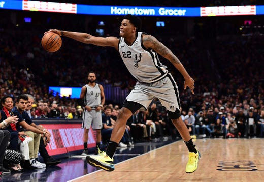 April 13: Spurs forward Rudy Gay reaches to secure a rebound during Game 1 against the Nuggets.