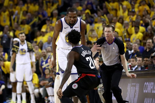 Kevin Durant and Patrick Beverley exchange words in Game 1.