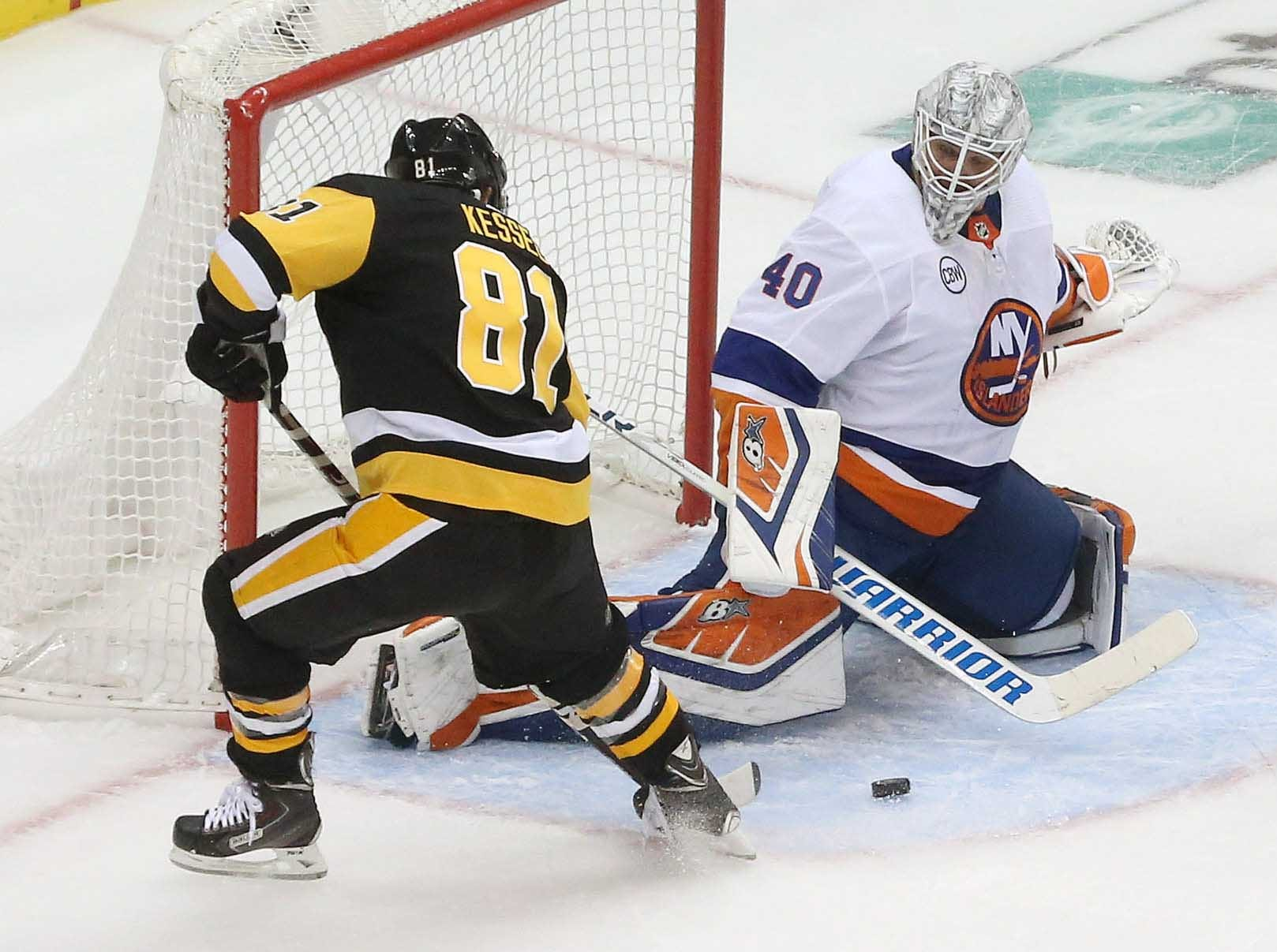 First round: New York Islanders goaltender Robin Lehner stops Pittsburgh Penguins forward Phil Kessel during the second period of Game 3.