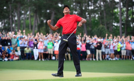 Tiger Woods celebrates after winning the 2019 Masters Tournament.