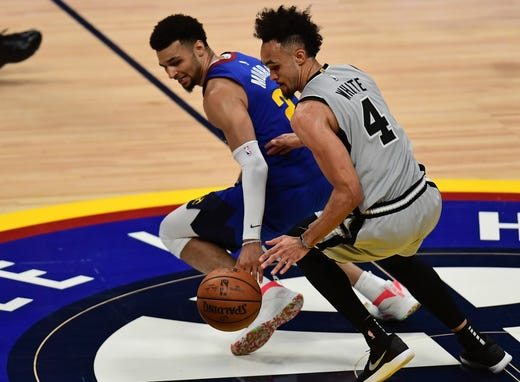 April 13: Spurs guard Derrick White steals the ball away from Nuggets guard Jamal Murray during the fourth quarter of Game 1.