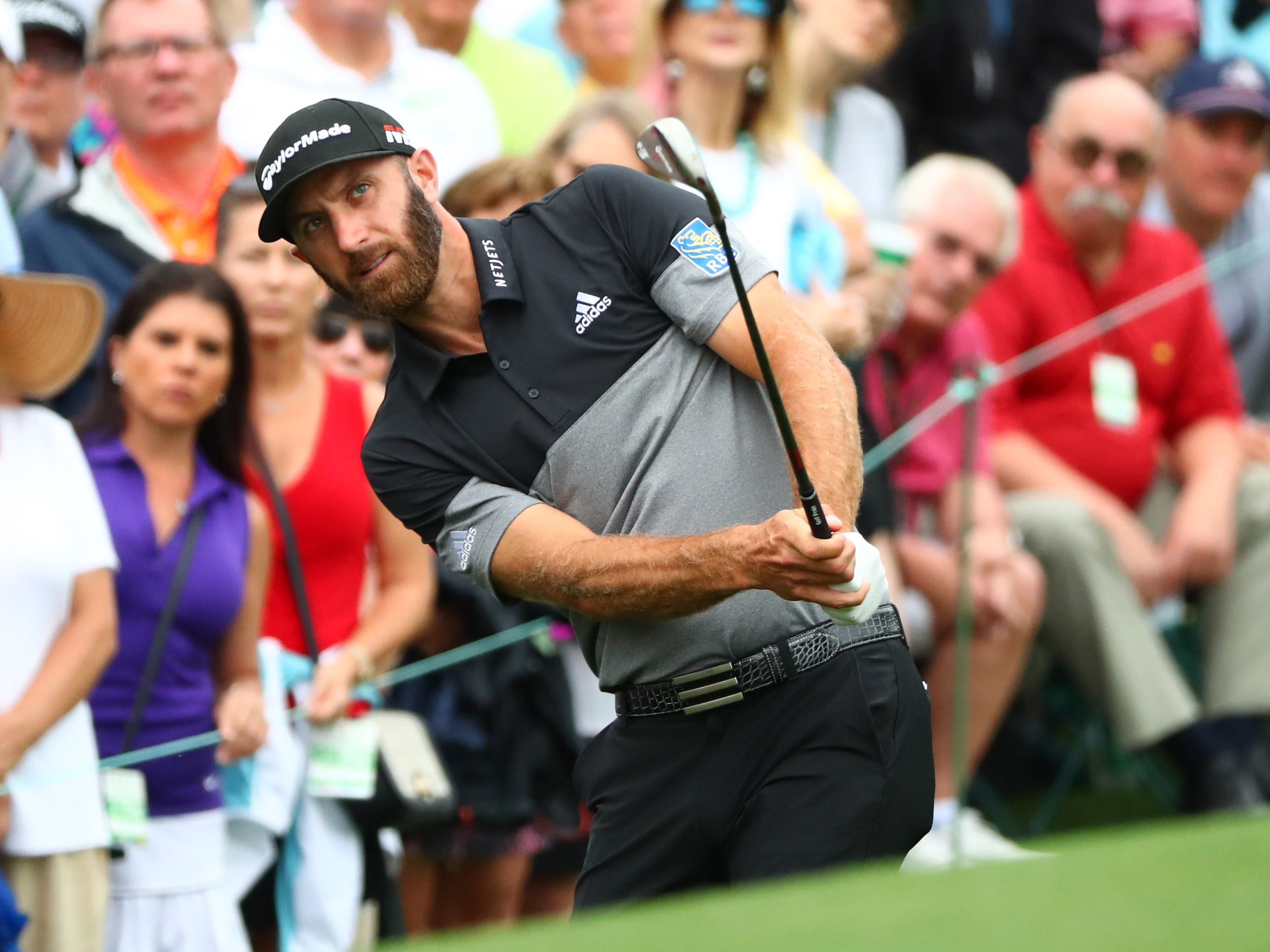 Dustin Johnson chips onto the second green.