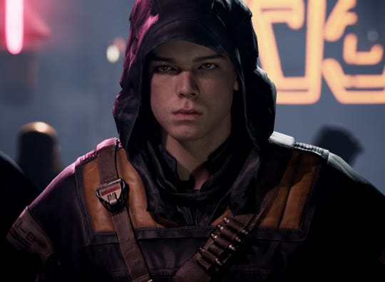 "Cal Kestis (played by Cameron Monaghan) is a Jedi Padawan who has to learn the ways of the Force while on the run from the Empire in the video game ""Star Wars Jedi: Fallen Order."""