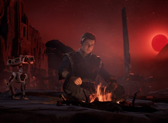 "Cal Kestis gets assistance from a helpful droid named BD-1 in ""Star Wars Jedi: Fallen Order."""