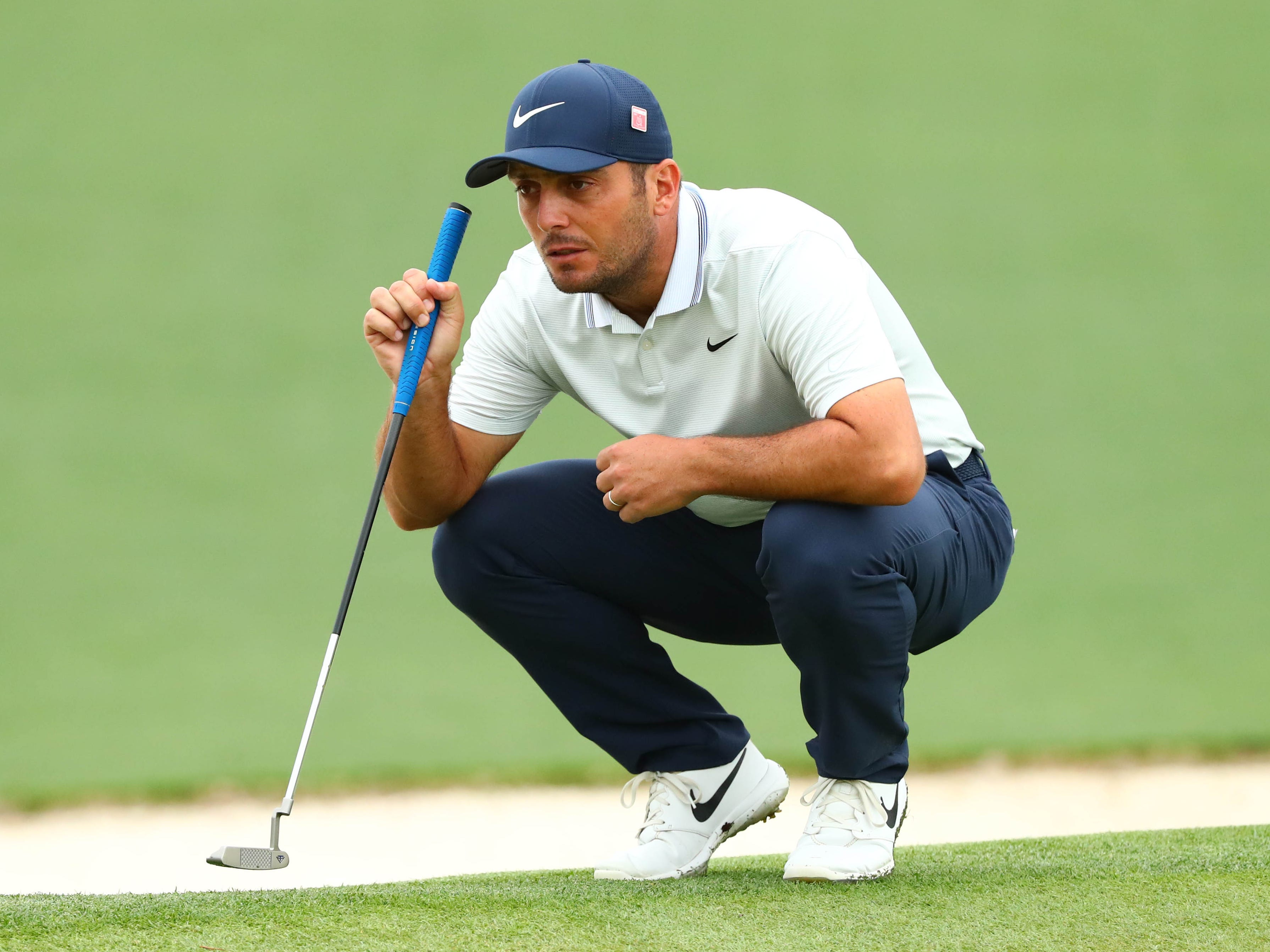 Francesco Molinari lines up a putt on the second green during the final round.