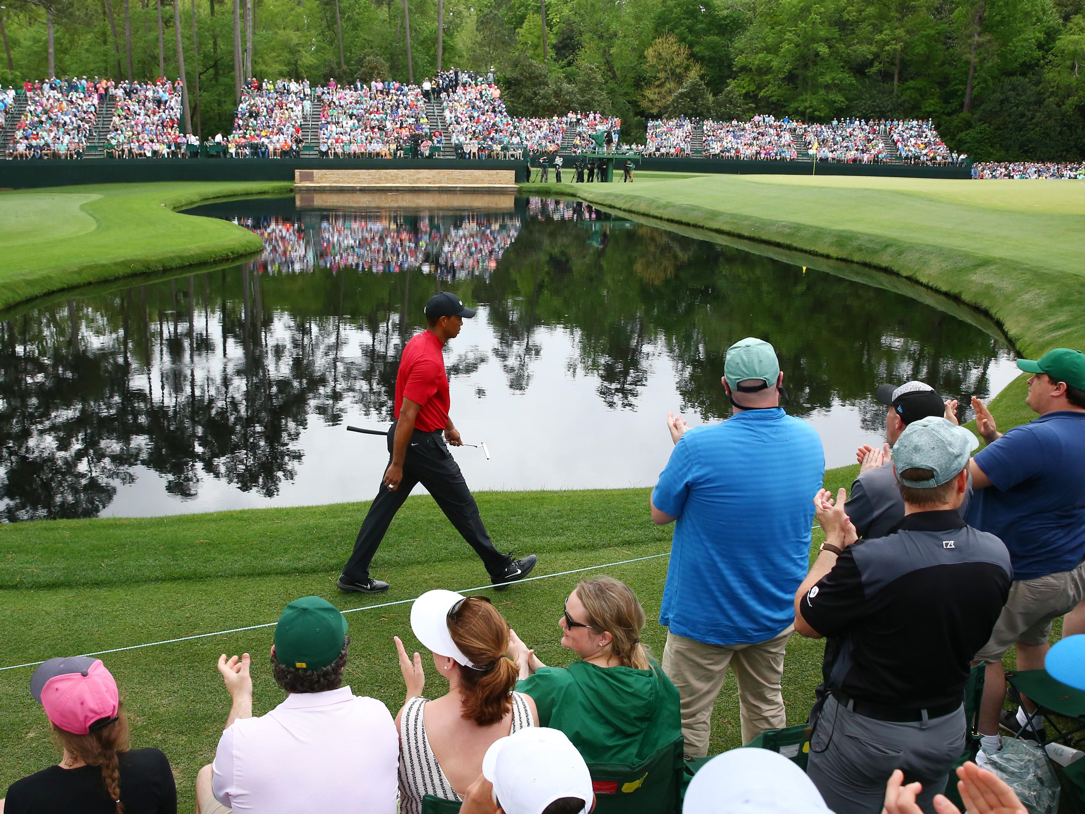 Tiger Woods walks to the 15th green during the final round of The Masters at Augusta National Golf Club.