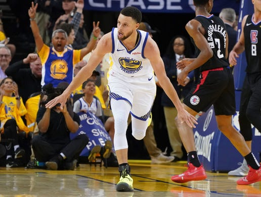 April 13: Warriors guard Stephen Curry celebrates a bucket during Game 1 against the Clippers.