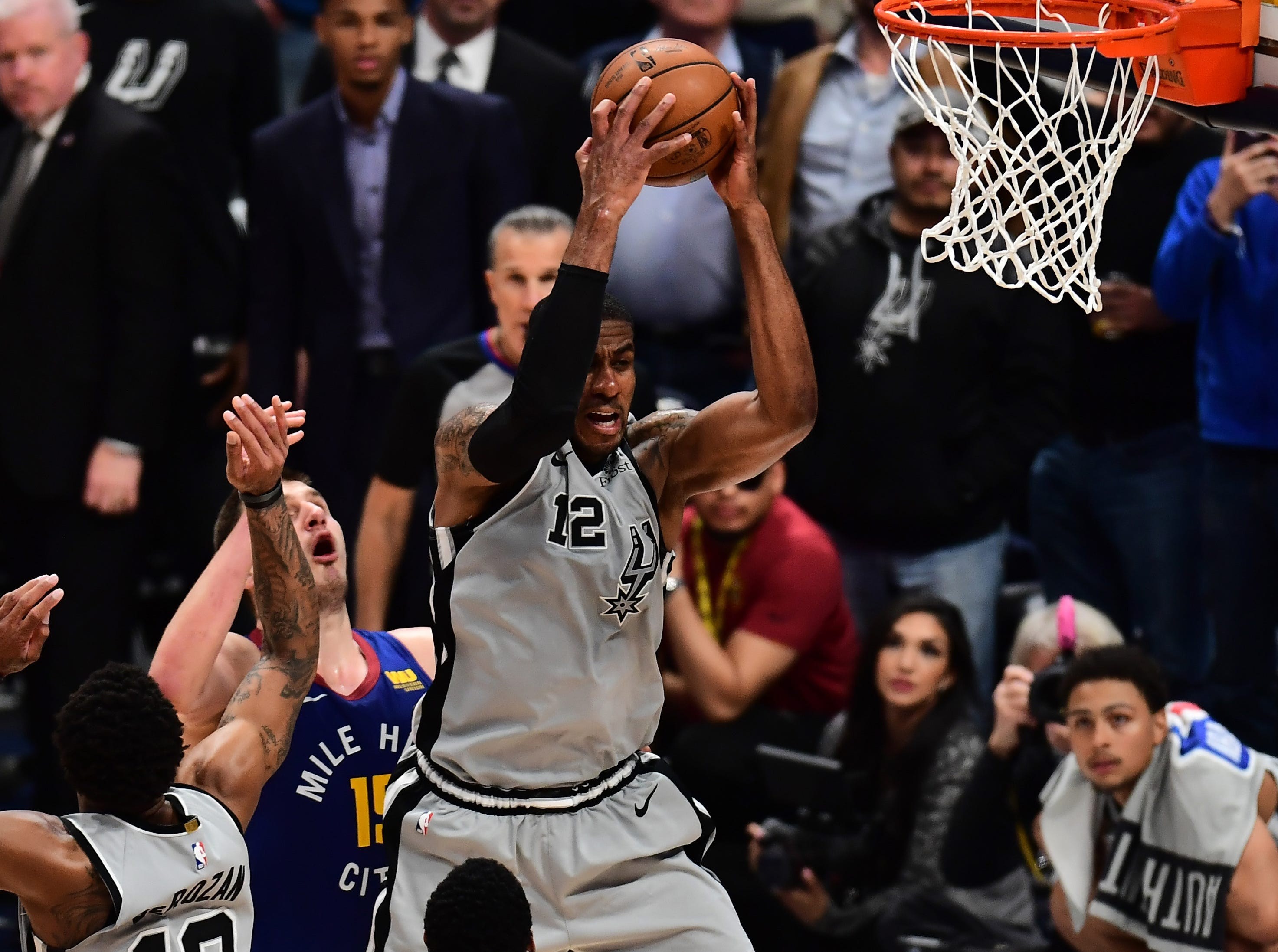 April 13: Spurs center LaMarcus Aldridge pulls in a rebound during Game 1 against the Nuggets.