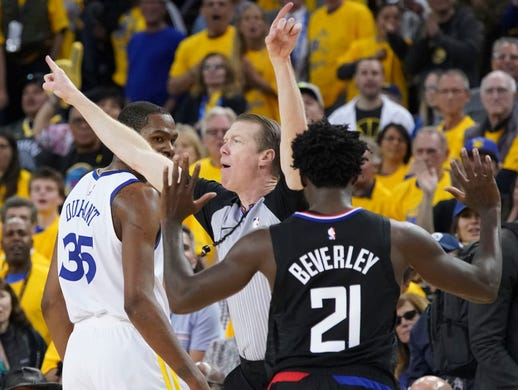 April 13: Referee Ed Malloy ejects Warriors forward Kevin Durant and Clippers guard Patrick Beverley during the fourth quarter of Game 1.