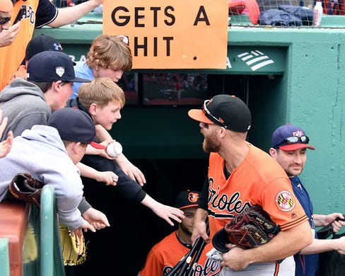 April 13: Baltimore Orioles first baseman Chris Davis (19) talks with fans as he walks into the tunnel after a game against the Boston Red Sox at Fenway Park. Davis ended his record drought with a three-hit performance.