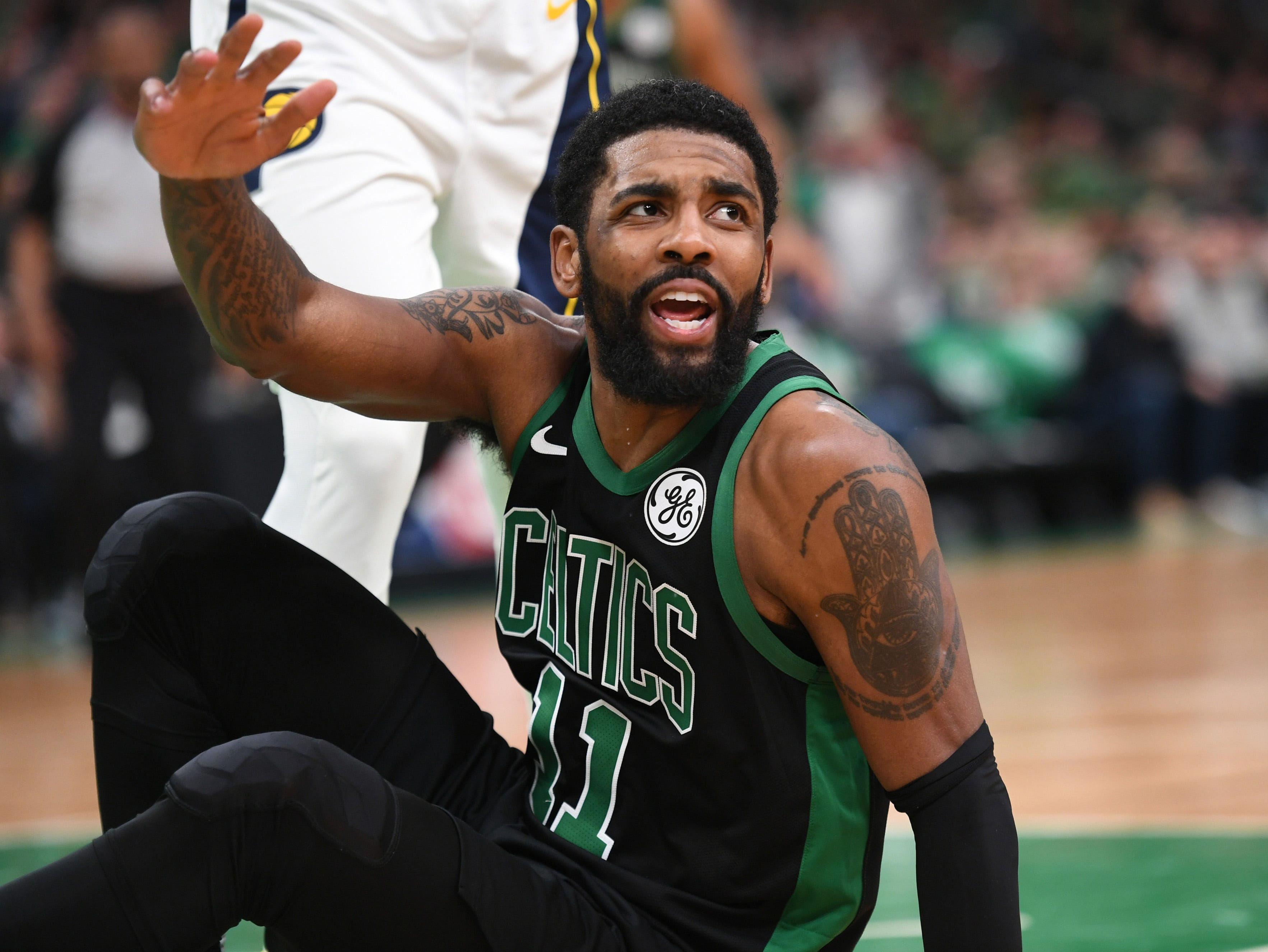 April 14: Celtics guard Kyrie Irving looks for a call during Game 1 against the Pacers.