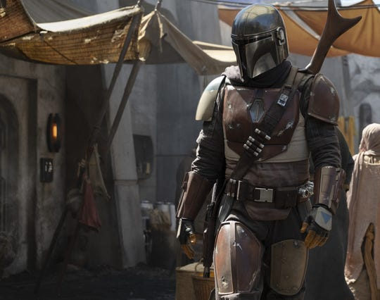 """Pedro Pascal stars as the helmeted galactic gunslinger in """"The Mandalorian,"""" the first live-action """"Star Wars"""" TV series."""
