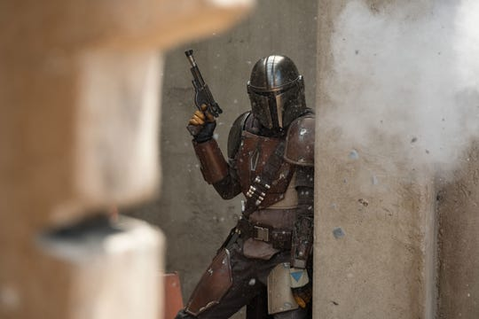 "The title gunfighter (Pedro Pascal) finds himself in a bad way in ""The Mandalorian,"" the first ""Star Wars"" live-action series."