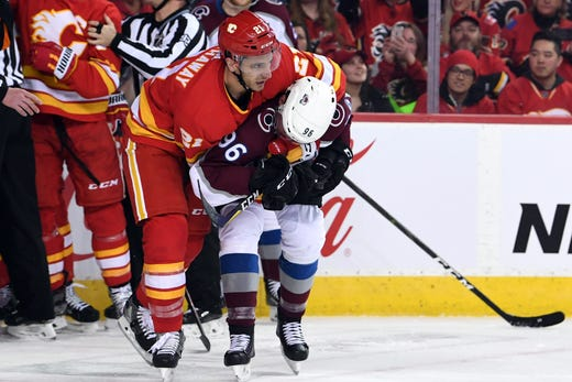 First round: Calgary Flames right wing Garnet Hathaway tangles with Colorado Avalanche right wing Mikko Rantanen in the first period of Game 2.