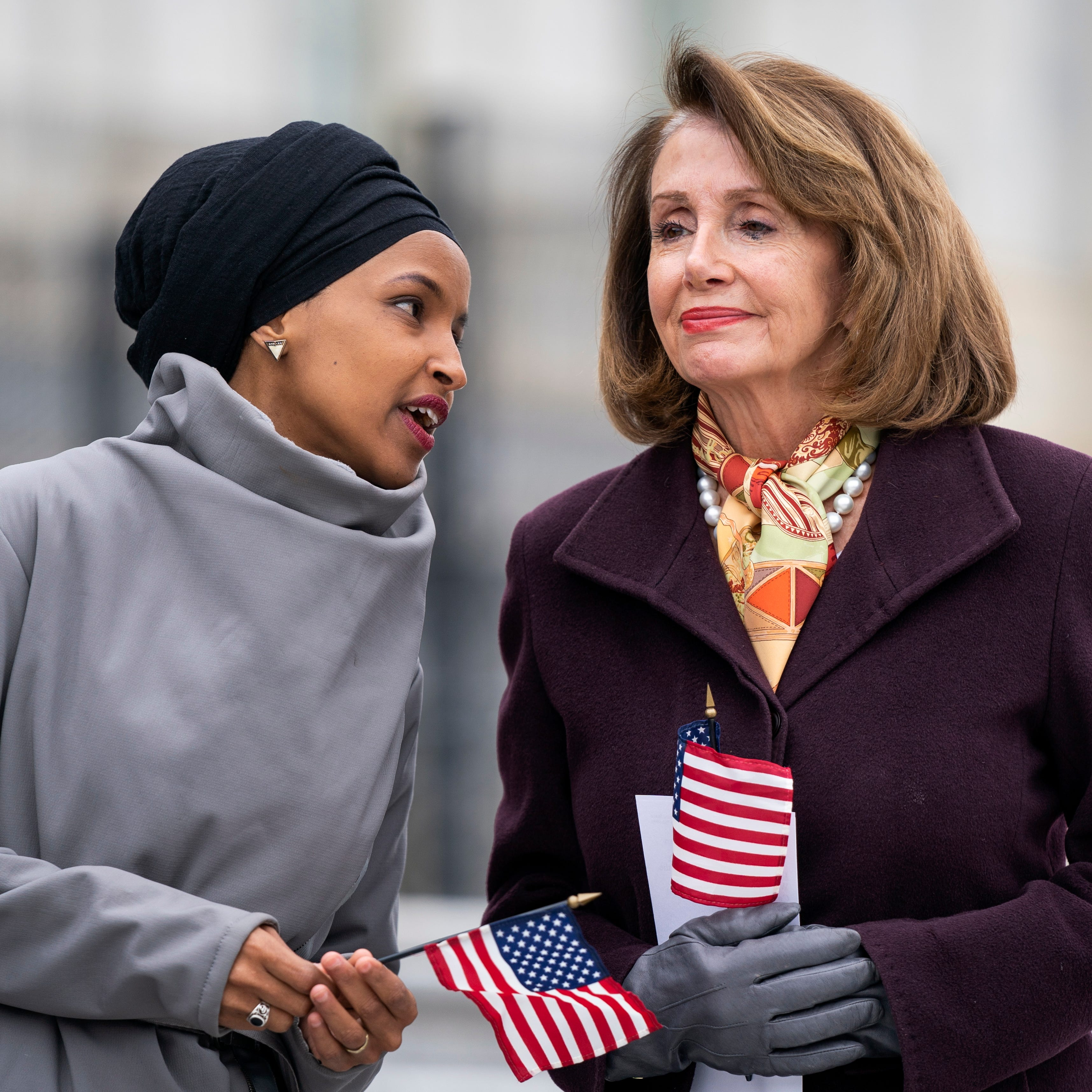 Rep. Ilhan Omar, D-Minn., and House Speaker Nancy Pelosi, D-Calif., attend a media event to push for campaign finance reform outside the U.S. Capitol in Washington, March 8, 2019.