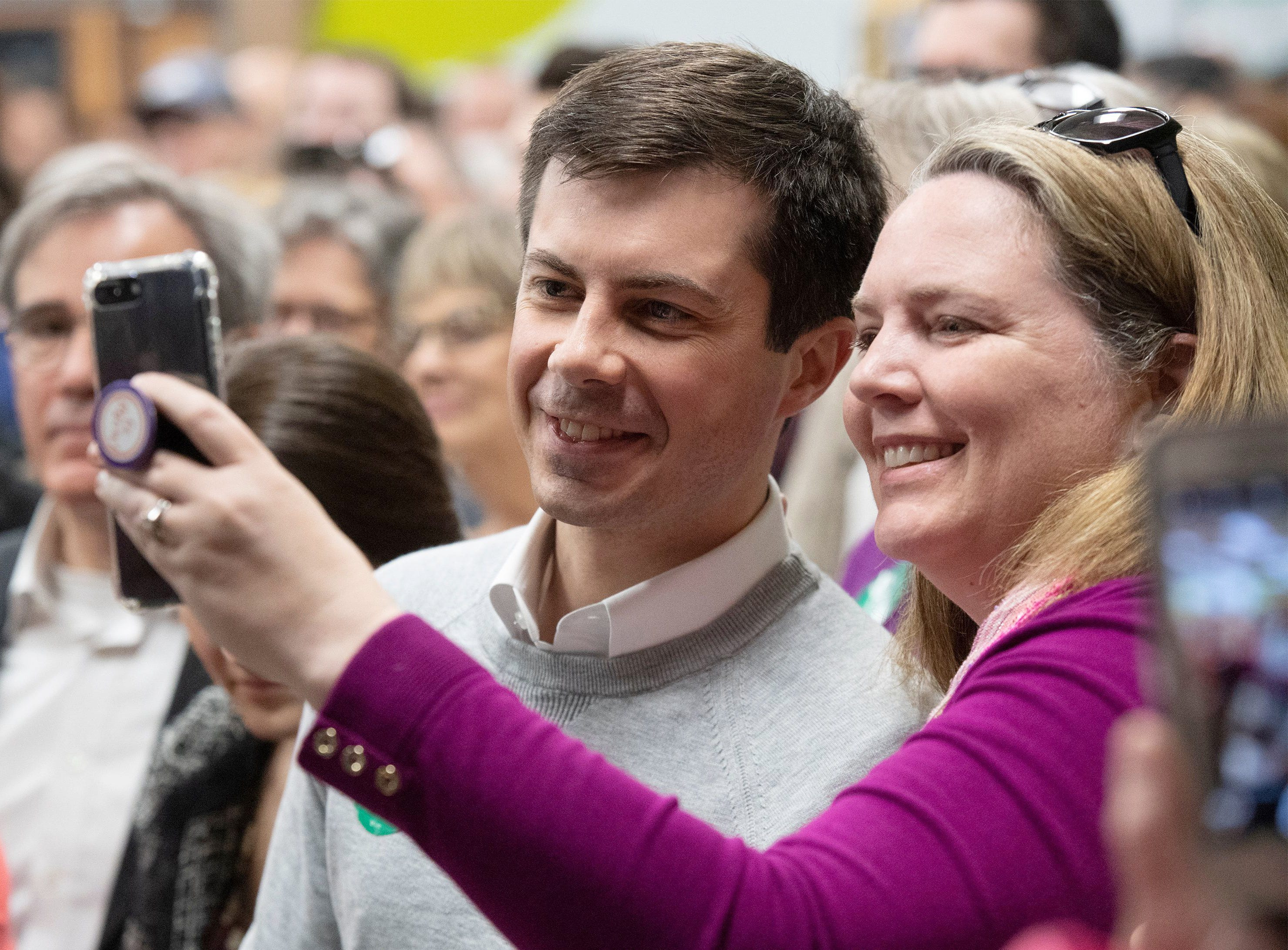 Salley Ouellette, from Pendleton, S.C., takes a photo with Pete Buttigieg at the Greenville County Democrats monthly breakfast held at Upstate Circle of Friends on Mar. 23, 2019 in Greenville, S.C. Buttigieg announced his bid on April 14, 2019, to run for president.