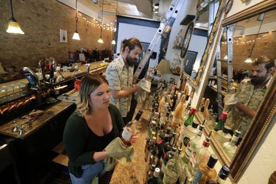 Proprietors Margot Reed and Christopher Fenn clean and arrange the bar at Nice Time. The new lounge will open Thursday at 125 E. College Ave. in downtown Appleton.