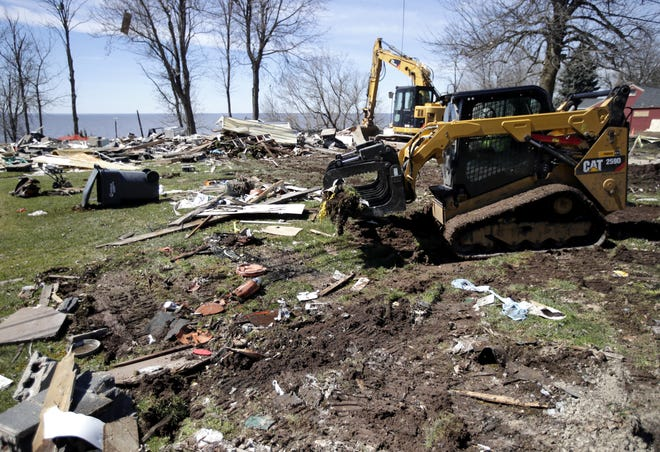 Gary Fox of Fox Excavating uses a compact track loader to remove debris from the lakefront property at W5639 Firelane 12 in Harrison. An Oct. 10 explosion destroyed the season home on the site.