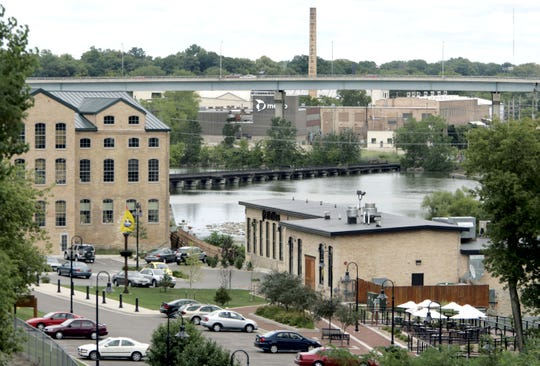 In this archived photo, Atlas Mill, at left, is home to Atlas Waterfront Cafe and the Paper Discovery Center. The building at the right is Fratellos.
