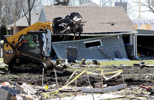 Gary Fox of Fox Excavating removes debris from the property at W5639 Firelane 12 in Harrison.