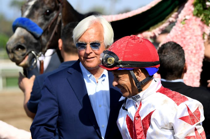 Jockey Mike Smith, right, stands next to trainer Bob Baffert after Roadster's win in the Santa Anita Derby horse race at Santa Anita in Arcadia, Calif., Saturday, April 6, 2019.