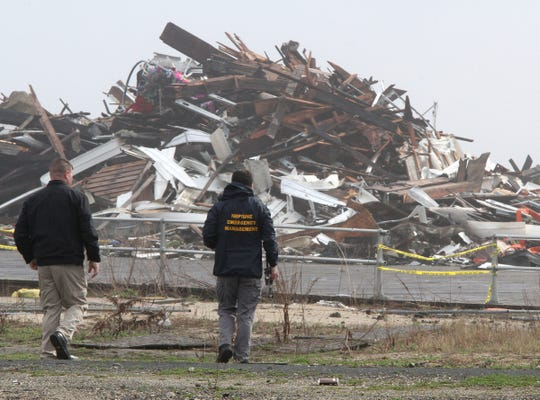 A Neptune Township Emergency Management prepares to launch their drone over a debris pile left behind Monday morning, April 15, 2019, after a Saturday fire destroyed the pavilion on the north end of the Ocean Grove boardwalk.