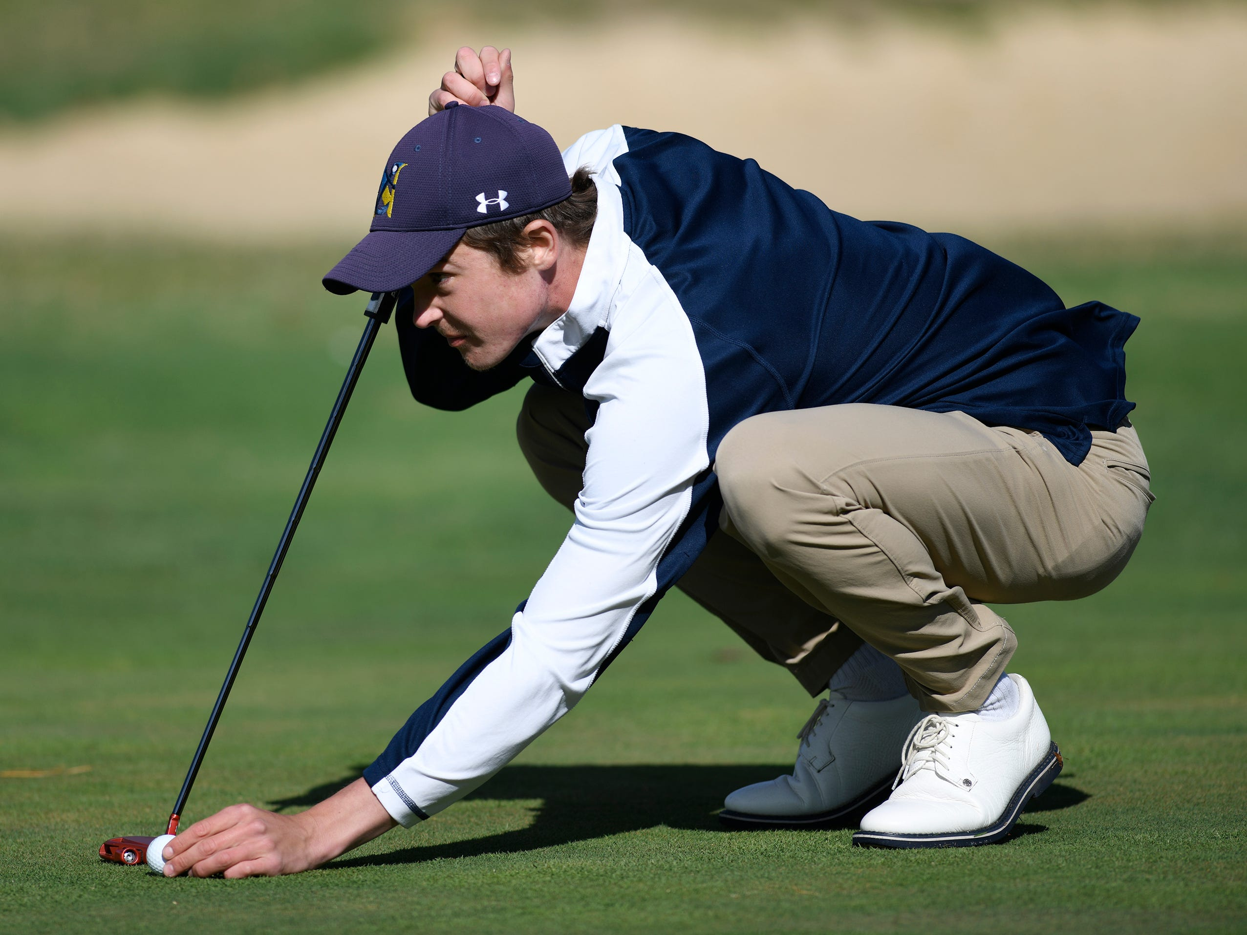 Connor Bekefi of Tome River North preps for a putt at the Ocean County Tournament on April 15, 2019,  at Sea Oaks in Little Egg Harbor. Toms River North's Connor Bekefi emerged as the individual champion with a 3-over-par 75, four shots better than teammate Leo Kane. Toms River North successfully defended its team title, posting a total of 336, which was 18 shots better than Southern. Brick Memorial finished third.