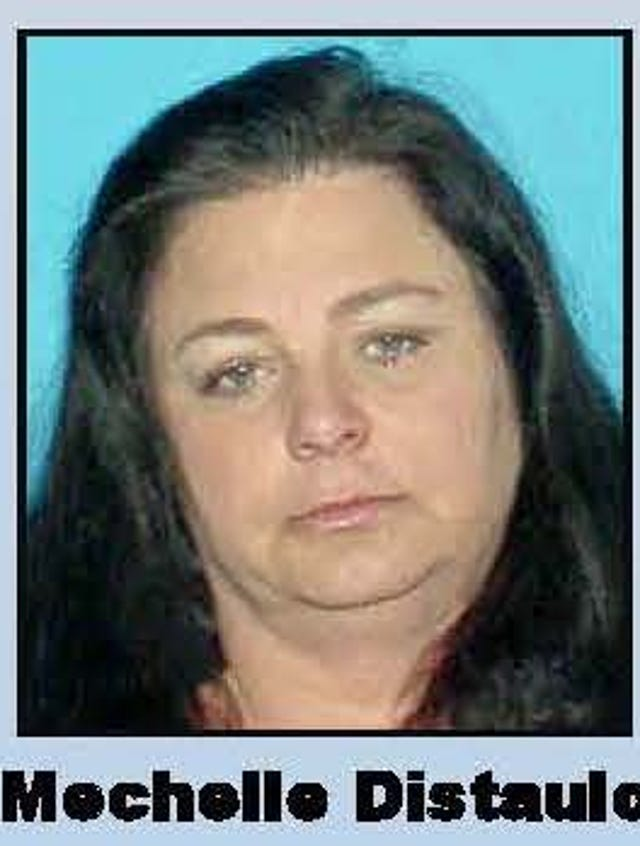 Ex-Bayshore mom accused of handing down heroin ring to son