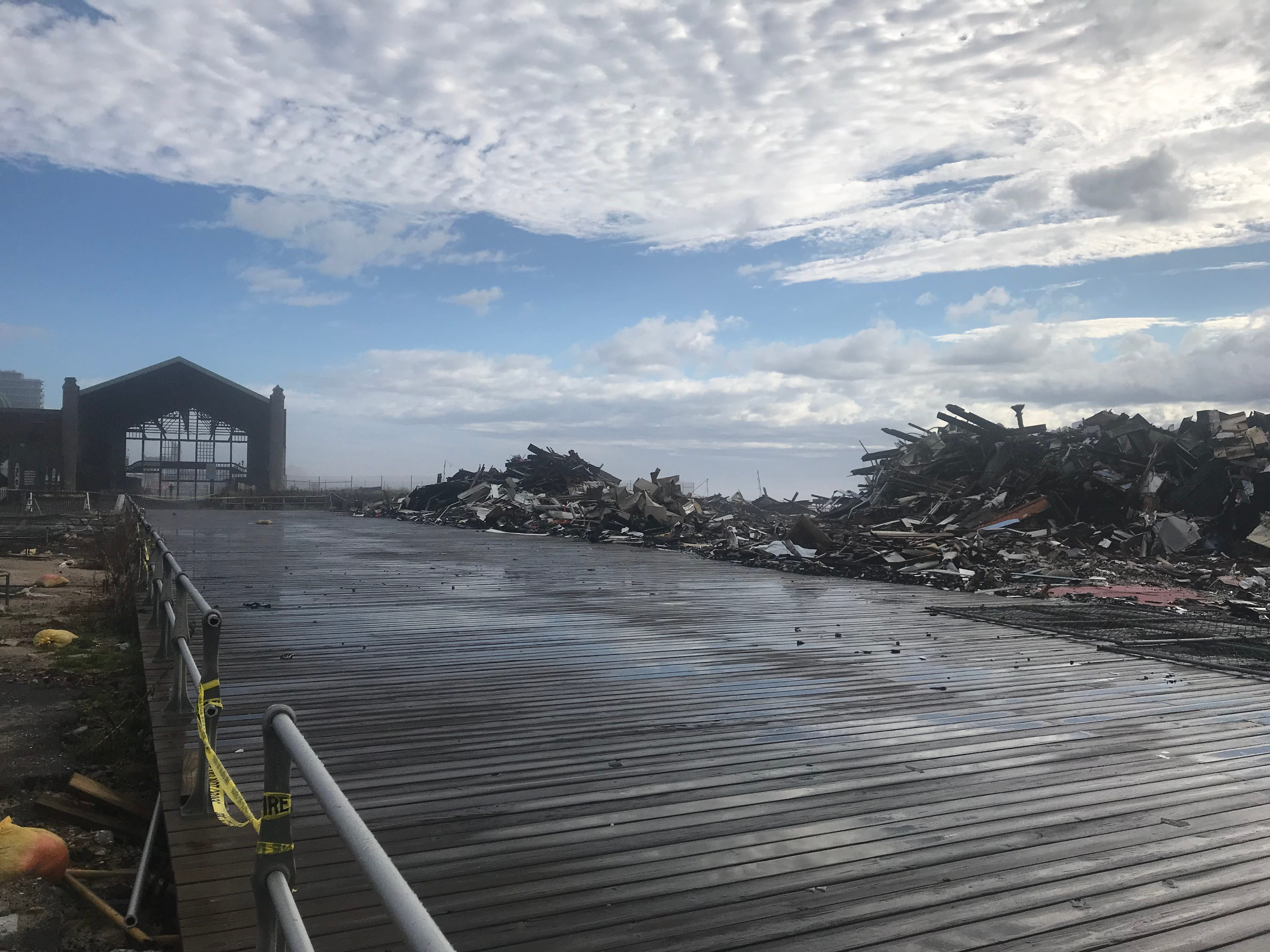 The Casino between Asbury Park and Ocean Grove can be seen in the background of the demolished pavilion destroyed by fire Saturday, April 13, 2019.