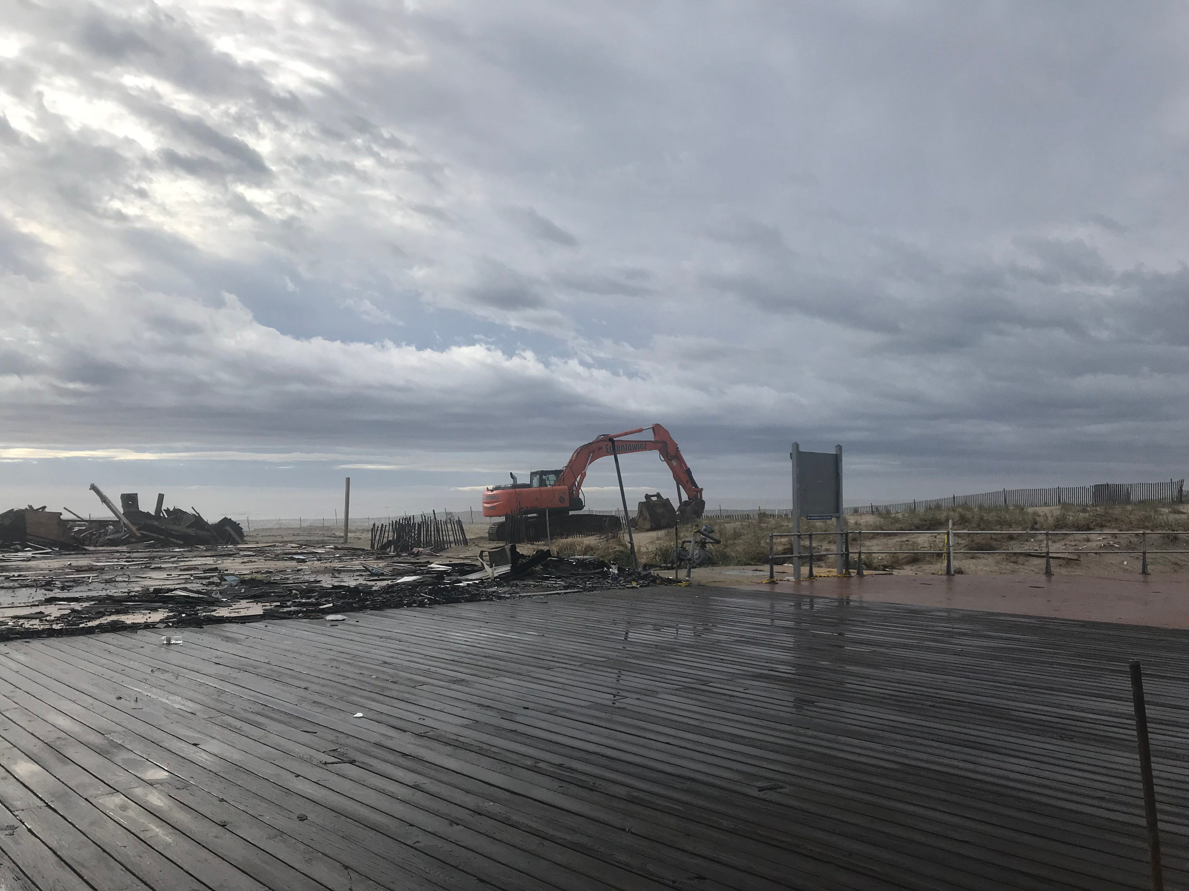A large construction excavator at the site of the demolished Ocean Grove boardwalk pavilion that was destroyed by fire Saturday, April 13, 2019.