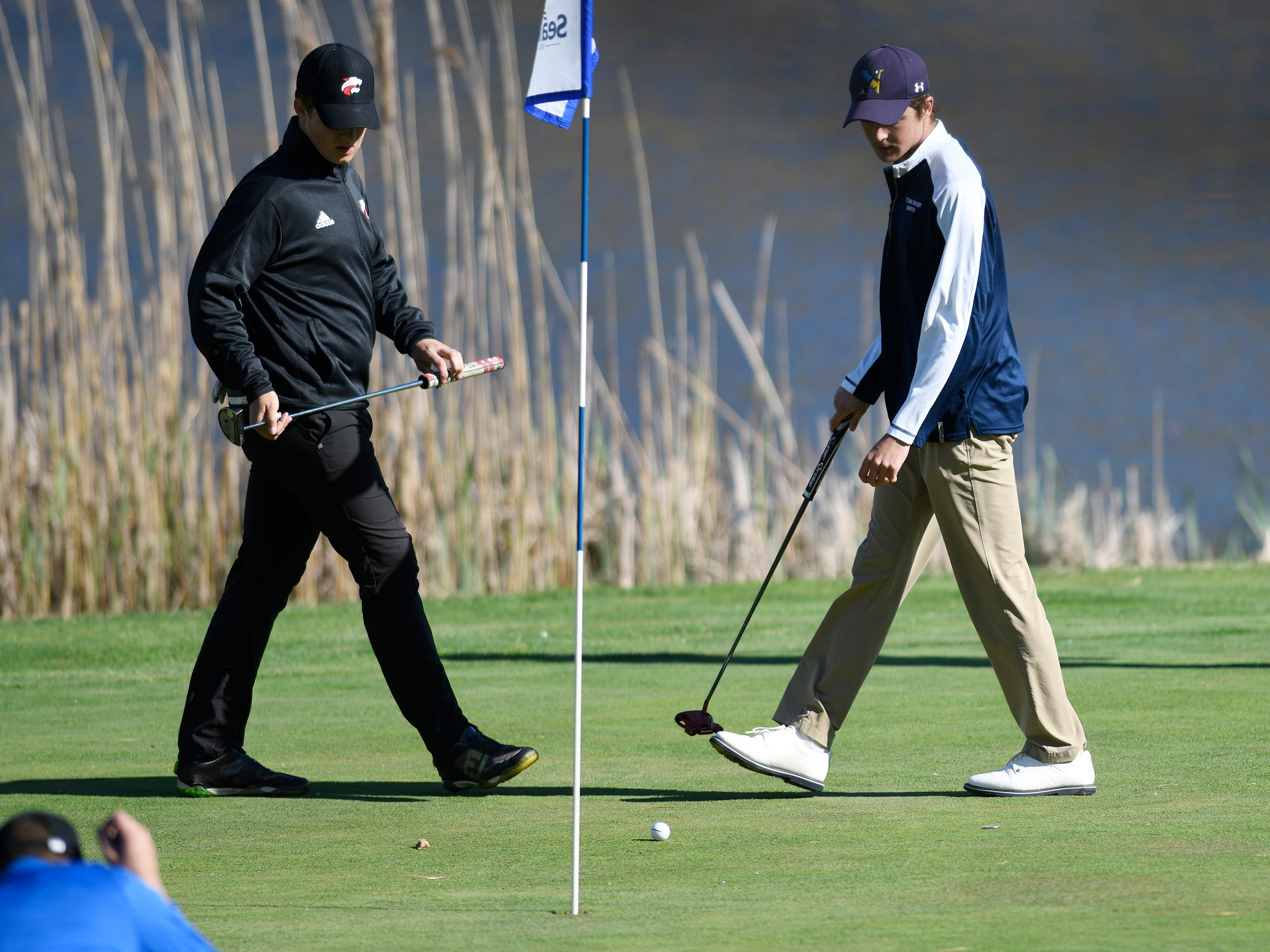 Kyle Rogers of Jackson Memorial, left, and Connor Bekefi of Tome River North competes at the Ocean County Tournament on April 15, 2019,  at Sea Oaks in Little Egg Harbor. Toms River North's Connor Bekefi emerged as the individual champion with a 3-over-par 75, four shots better than teammate Leo Kane. Toms River North successfully defended its team title, posting a total of 336, which was 18 shots better than Southern. Brick Memorial finished third.