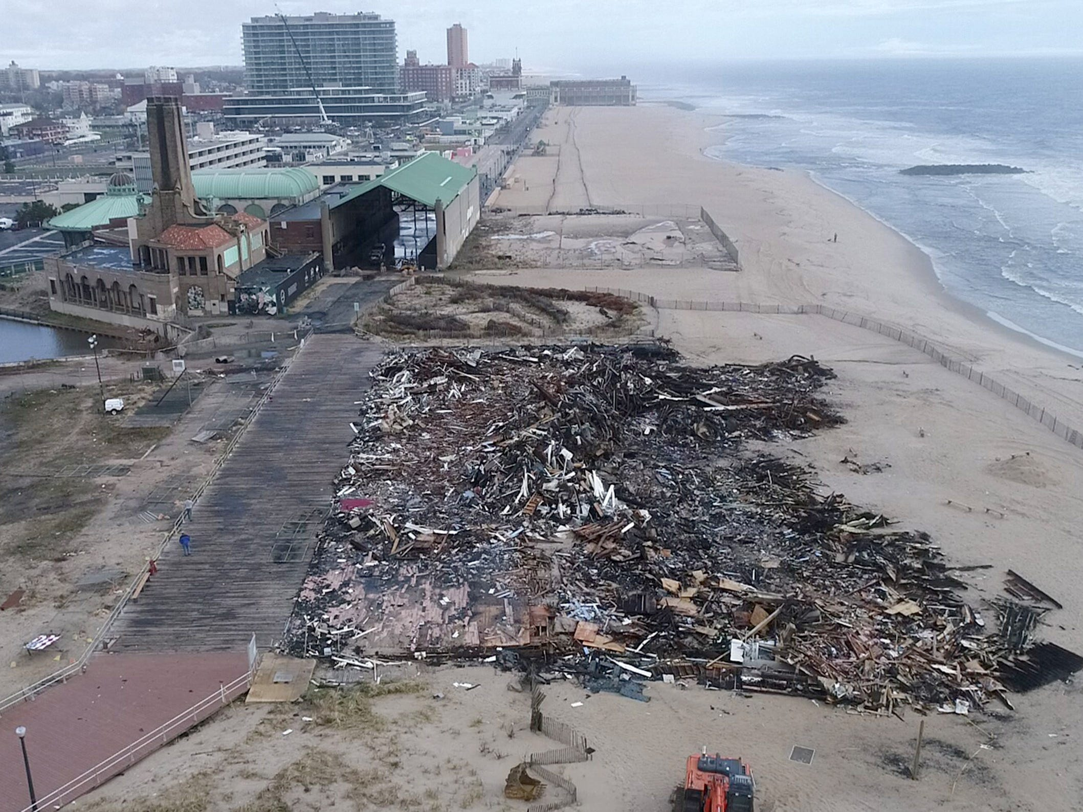 The debris pile left behind Monday morning, April 15, 2019, after a Saturday fire destroyed the pavilion on the north end of the Ocean Grove boardwalk.