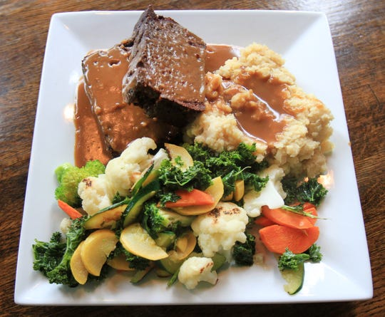 A dish of fresh vegetables, mashed potatoes and lentil loaf topped with brown gravy at Kaya's Kitchen in Belmar.