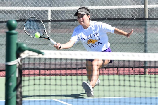 Wylie's Analeah Elias hits a shot during the District 4-5A tournament. Elias and mixed doubles partner Lane Adkins fought back from down a set to win the title entering this week's Region I-5A tournament.