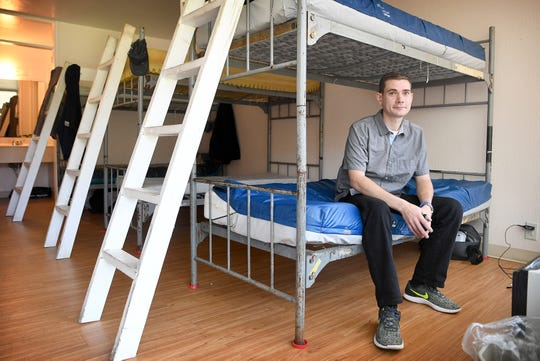 Steven Marsh, 32, was taken in to the Veterans Restoration Quarters by Asheville Buncombe Community Christian Ministry during Hurricane Florence, a Code Purple event, in September. He is photographed in one of the facility's overnight rooms where he was offered a place to stay after the hurricane. He is now in ABCCM's civilian program and is saving for a little extra financial security when he gets his own apartment.