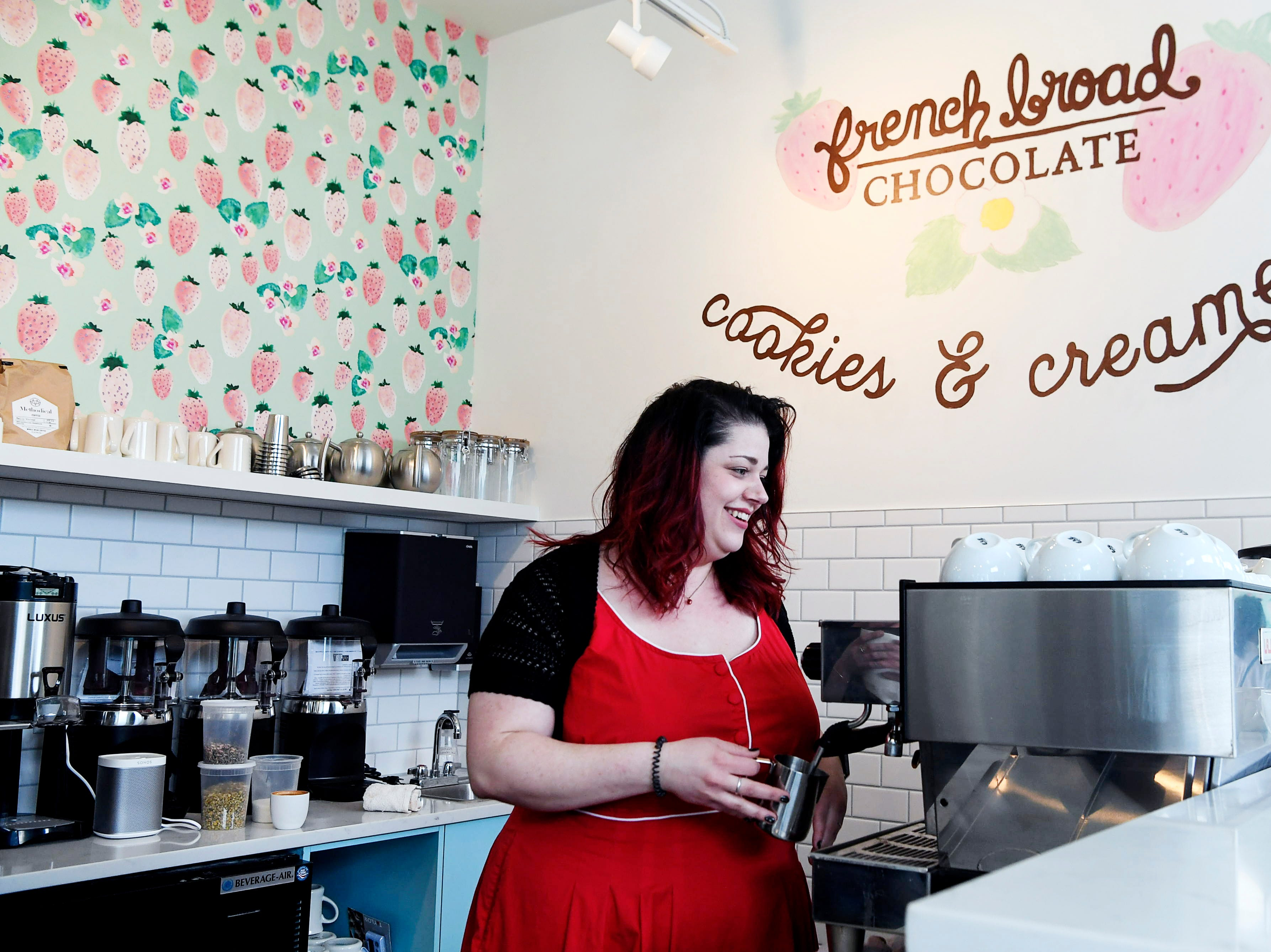 Chloe Davidson stands at the espresso machine at French Broad Chocolates' new Cookies & Creamery April 8, 2019.