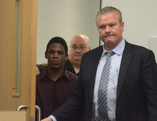 Davion Brown with his attorney, Donald Sappanos, right, enters the courtroom Monday before rejected a plea offer in a first-degree murder case.