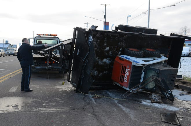 Crews begin to clear the wreckage of a crash at the intersection of Main Street and Columbia Avenue.