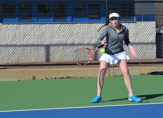 Harper Creek's Julia Hooker returns serve at No. 1 singles during a match with Lakeview earlier this season.