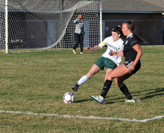 Pennfield's Karra Beech and Lakeview's Anna Metzger fight for possession for the ball during this city rivalry contest earlier this season.