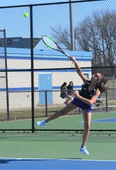 Lakeview's Aryana Banerji serves to Julia Hooker during a match at No. 1 singles against Harper Creek earlier this season.