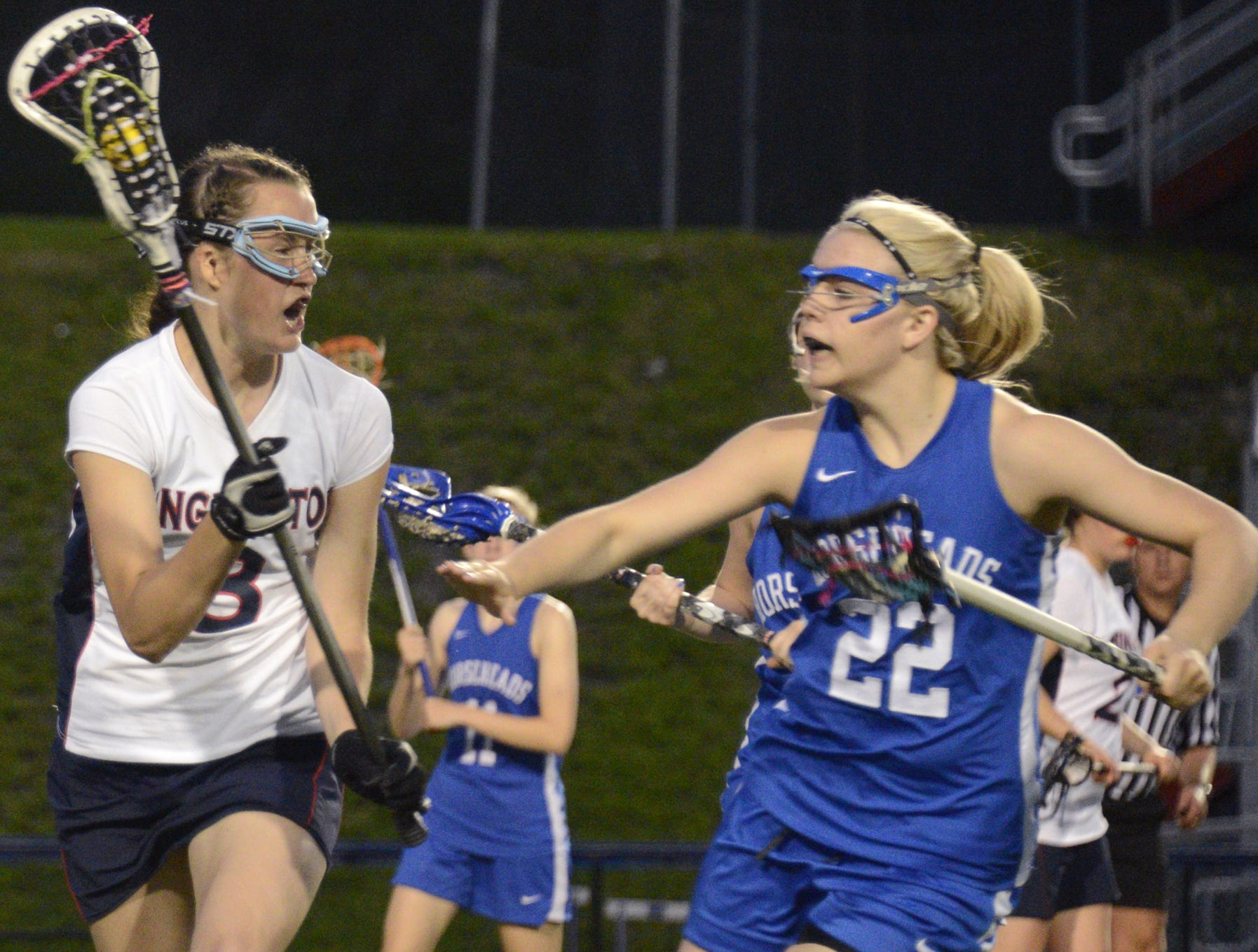 2013: Binghamton's Erin Holleran is defended by Horseheads' Cassidy Tingley in the second half Wednesday night at Alumni Stadium. Binghamton lost, 14-5. Katie Gaudet scored two goals for the Patriots.