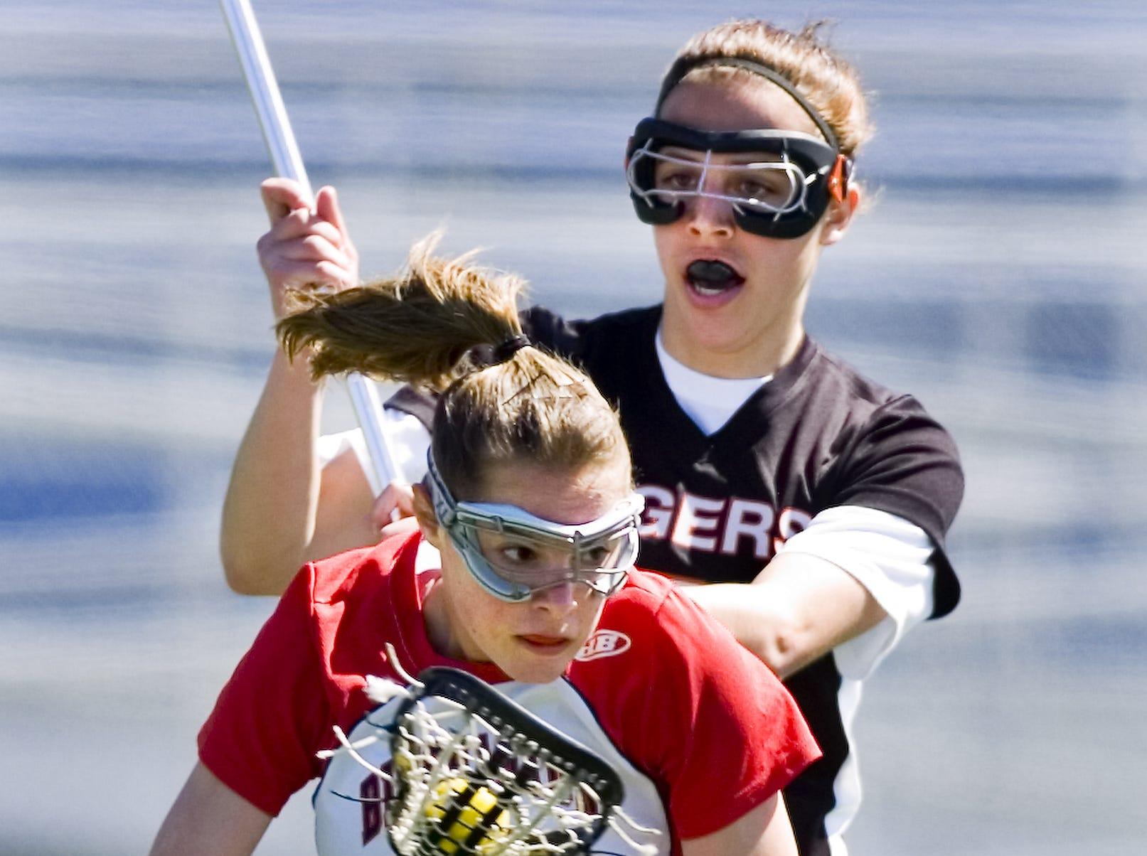 2007: Union-Endicott's Adrianna Gaeta closes in on Binghamton's Melissa Peterson during their STAC lacrosse match on Wednesday. Binghamton won, 16-13.