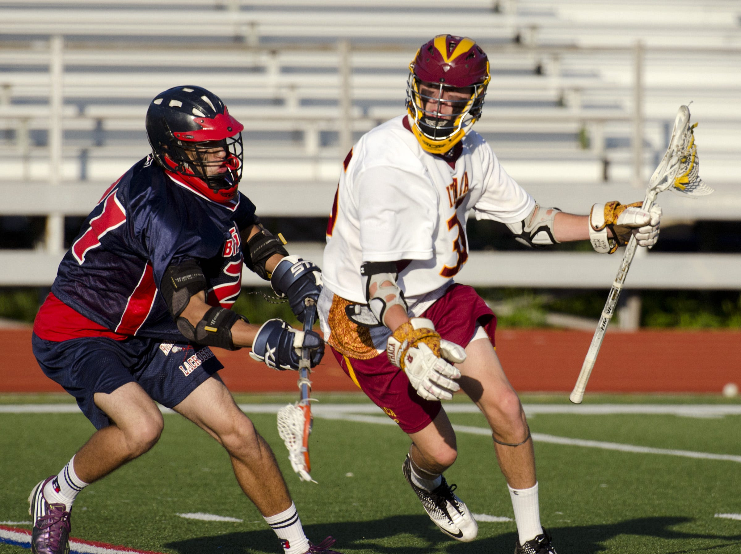 2012: Ithaca's Paolo Ciferri is guarded by Binghamton's Cody Graham just before Ciferri scores in the first half.