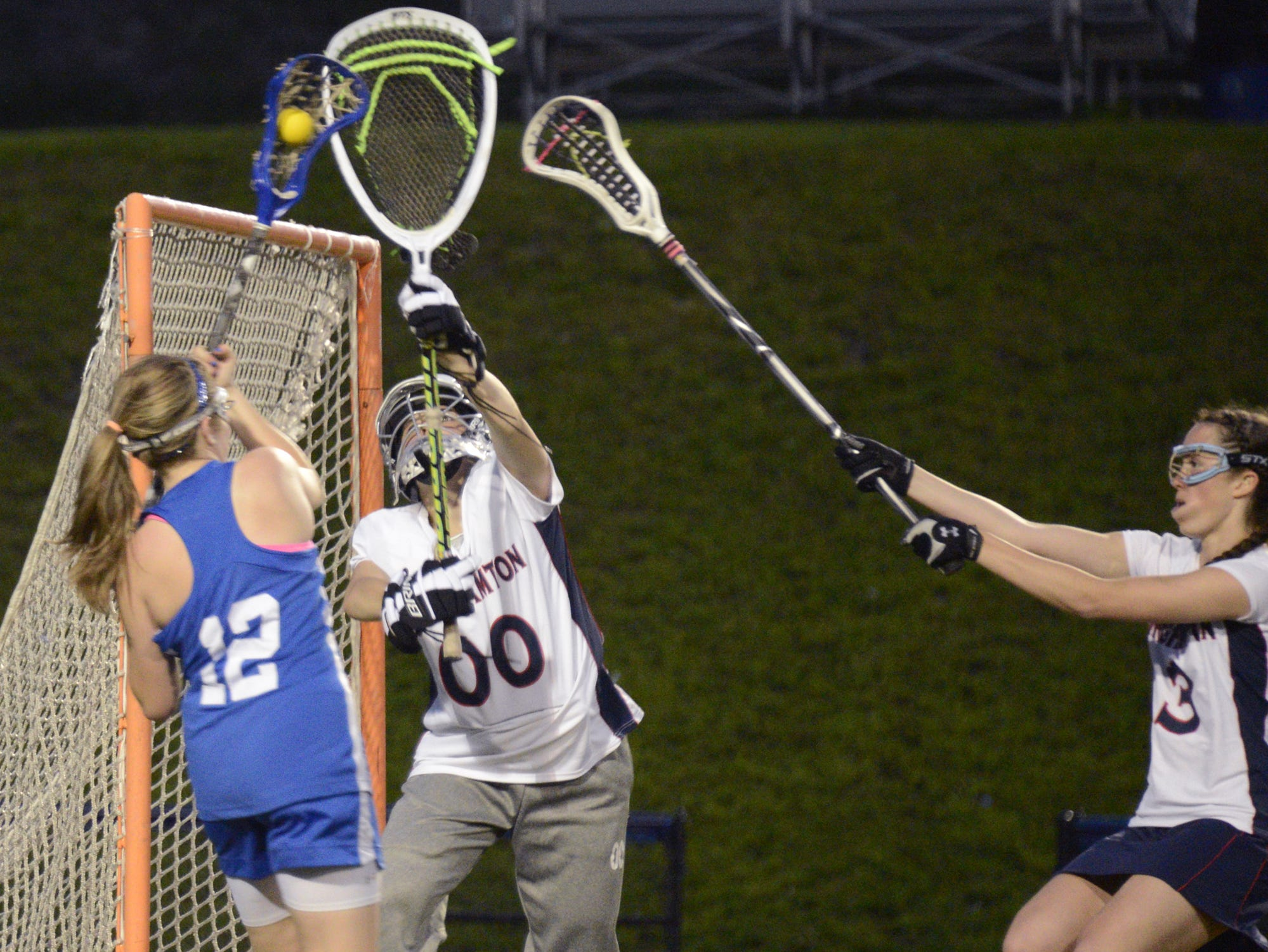 2013: Horseheads' Tess Sydlo attempts a shot on Binghamton goalie Deme Zervos, as Erin Holleran, also of Binghamton, chases from behind in the second half Wednesday at Alumni Stadium in Binghamton.