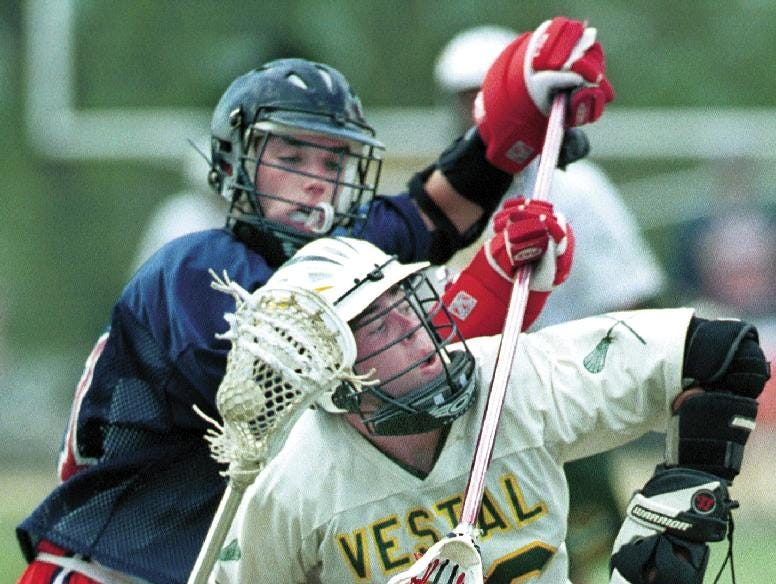 1999: Binghamton senior Dustin Melville, 21, attempts to get control of the ball from Vestal's Ryan Harris, 22, mid-way through the third period of Tuesday's game at David K. Sammon Field in Vestal.