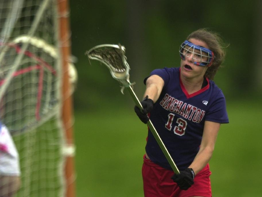 2004: Binghamton High School's Kristin Brady, the girls' lacrosse team captain, takes a shot on goal during a Wednesday game at Chenango Forks.
