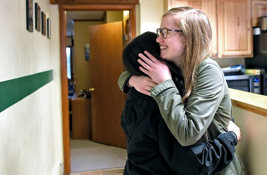 Alyssa Lat, a Binghamton University junior from Rockland County, and Hannah Bronson, a sophomore from Lansing, hug in the Newman House. Both Lat and Bronson are active in BU's Catholic community, which meets in the Newman House.